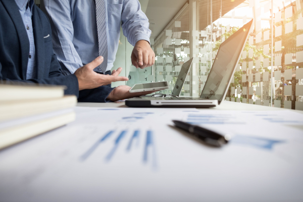 Business Adviser Analyzing Financial Figures Denoting The Progre